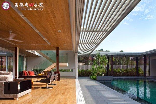 景观自然联系的现代四合院式别墅,两个长方形的主建筑和四周的回廊,围